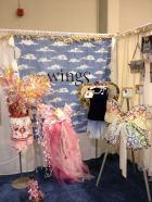 Charity Wings booth. Photo by Scarlet Calliope