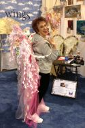 Suze Weinberg in the Charity Wings booth. Photo by Scarlet Calliope.