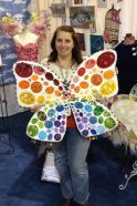 Kendra Wiggins with her beautiful wings she made for Charity Wings. Photo by Scarlet Calliope.