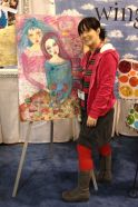 Suzi Blu with her mixed media work of art. Photo by Scarlet Calliope.